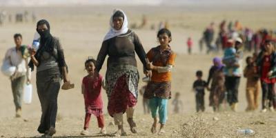 cristianos-huyendo-de-irak_560x280